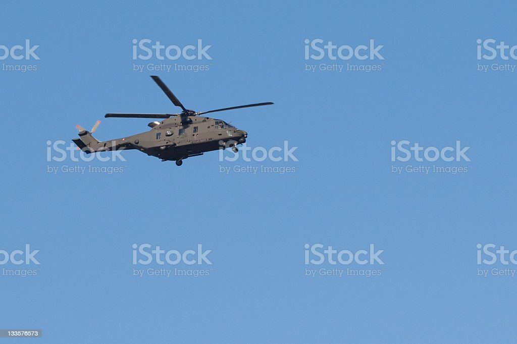Military Helicopter Flying in a Blue Sky royalty-free stock photo