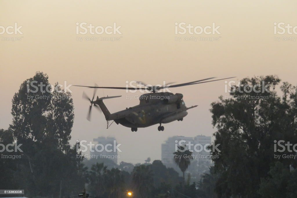 military helicopter landing stock photo