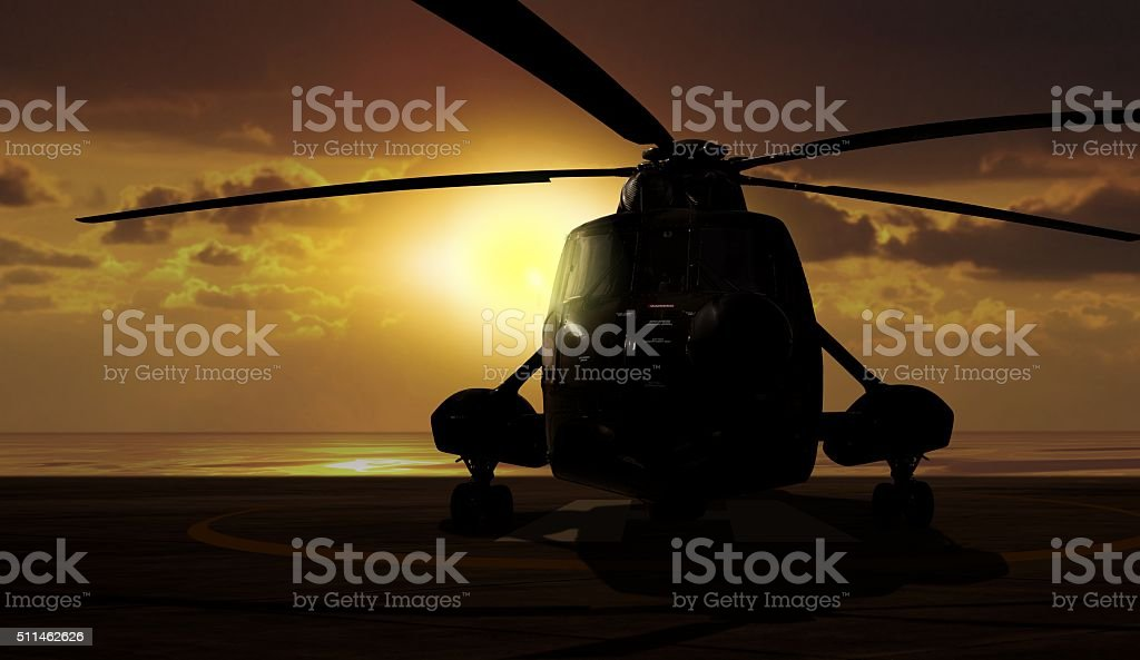 Military helicopter on carrier ship at sunset stock photo