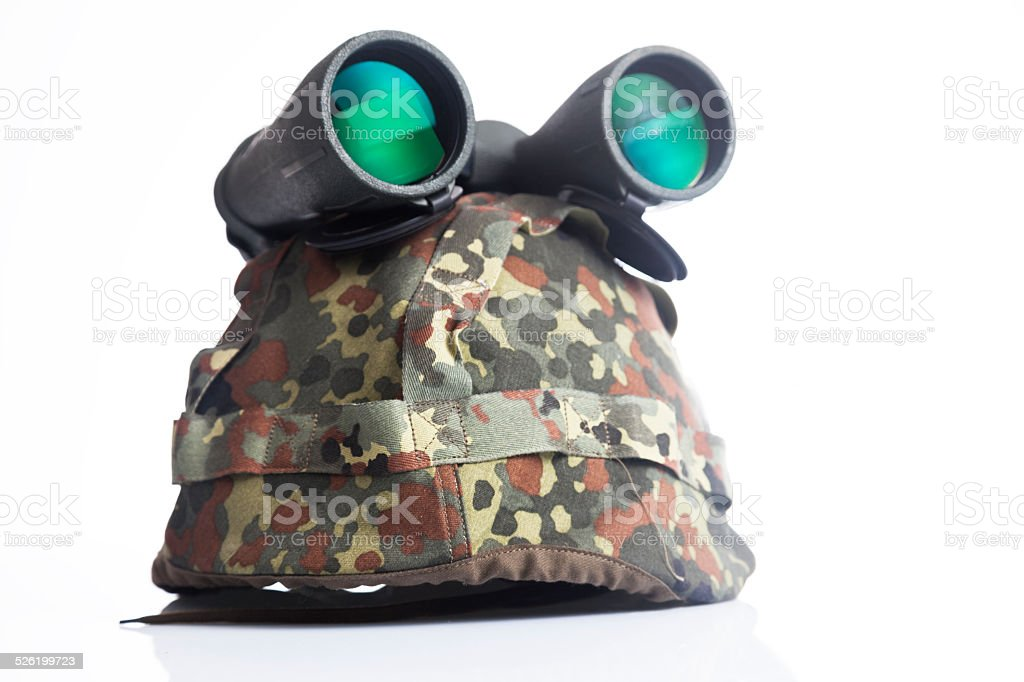 Military helmet and binoculars isolated on a white background stock photo
