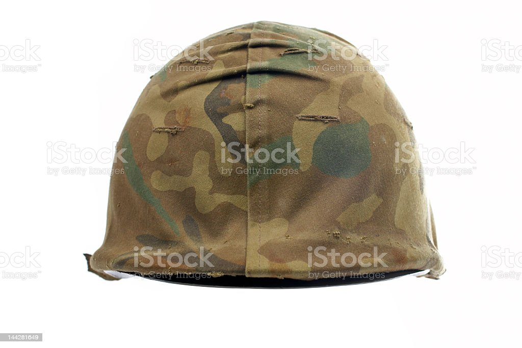 Military helmet in brown and camouflage royalty-free stock photo