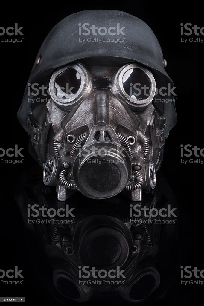 Military Helmet with Goggles and Gas Mask stock photo