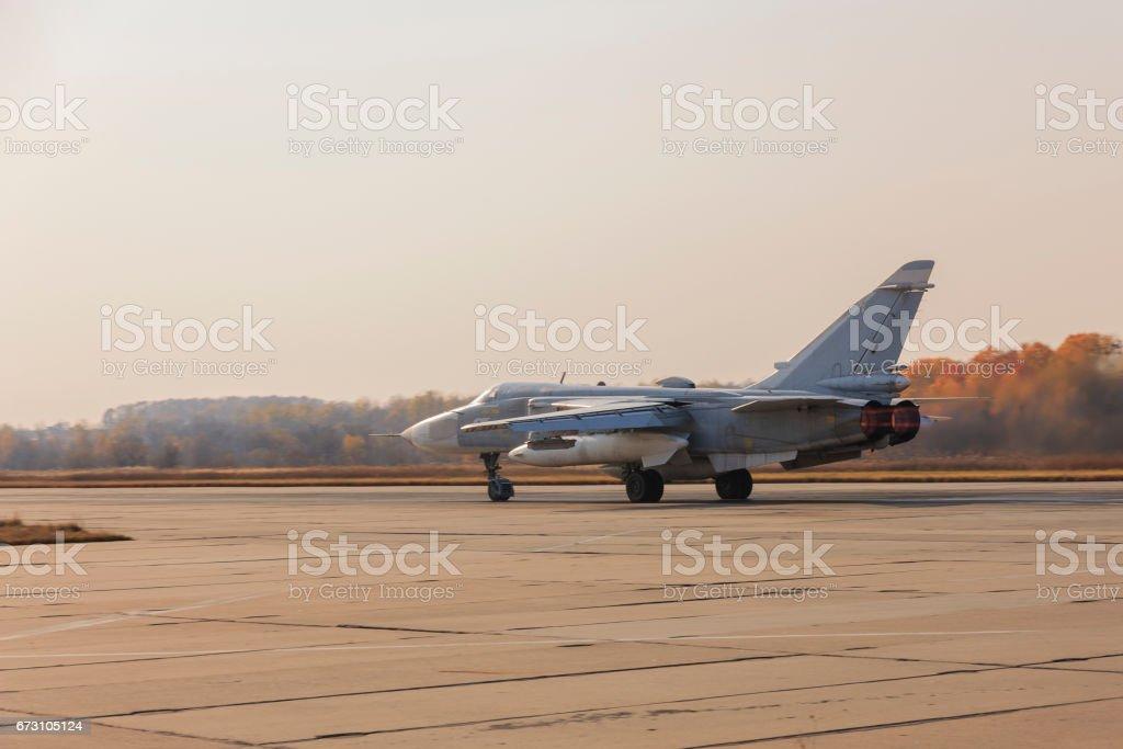 Military jet bomber Su-24 Fencer afterburner takeoff stock photo