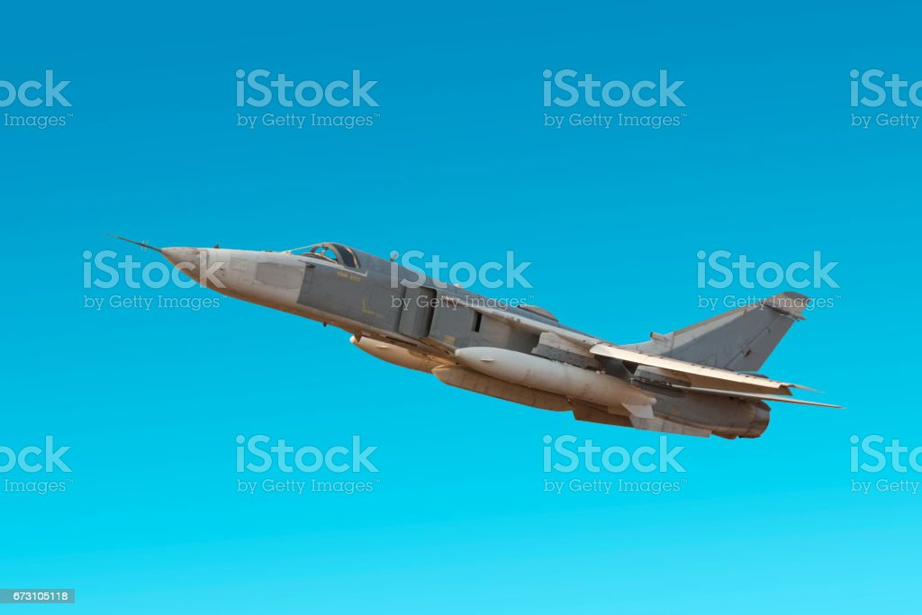Military jet bomber Su-24 Fencer flying a blue background stock photo