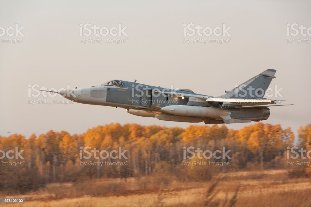 Military jet bomber Su-24 Fencer flying stock photo