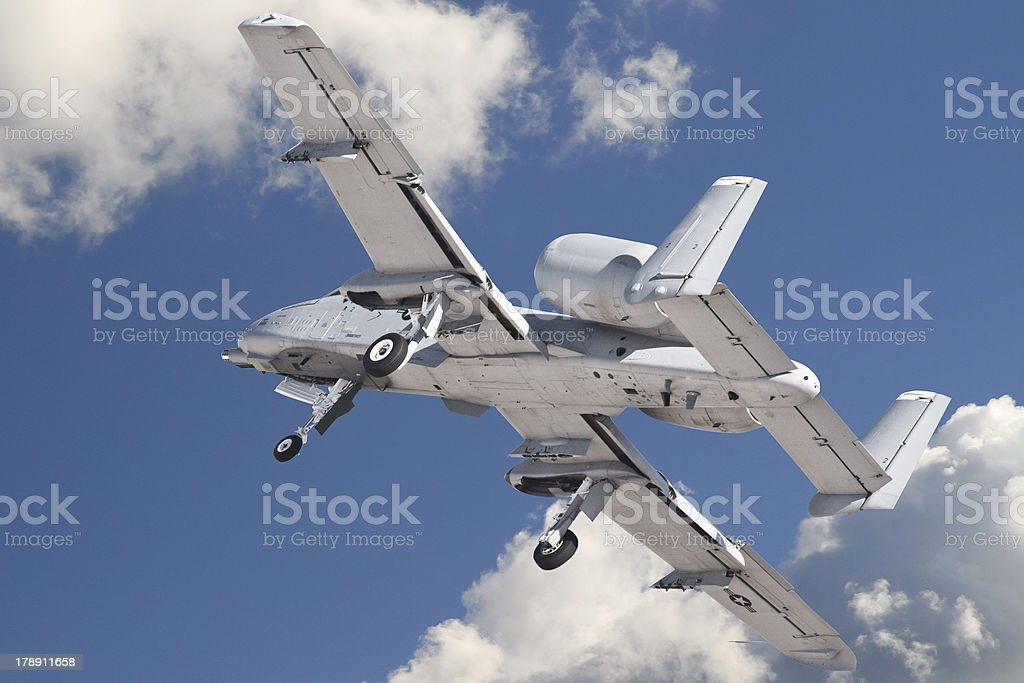 Military Jet Flies into the Clouds with Clipping Path royalty-free stock photo