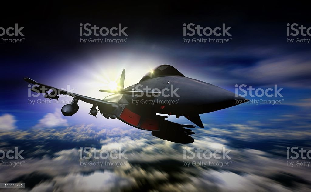 Military jet flying during sunrise with blur motion background stock photo