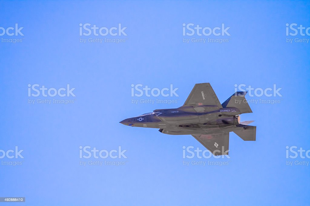 Military jet taking hoovering flying stock photo