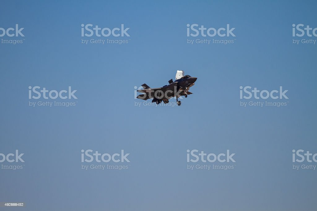 Military jet taking hoovering in the air stock photo