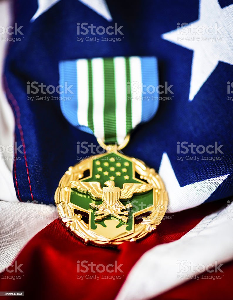 Military Joint Service Commendation Medal on American Flag royalty-free stock photo