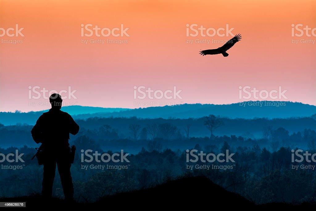 Military Man and Bird of Prey stock photo