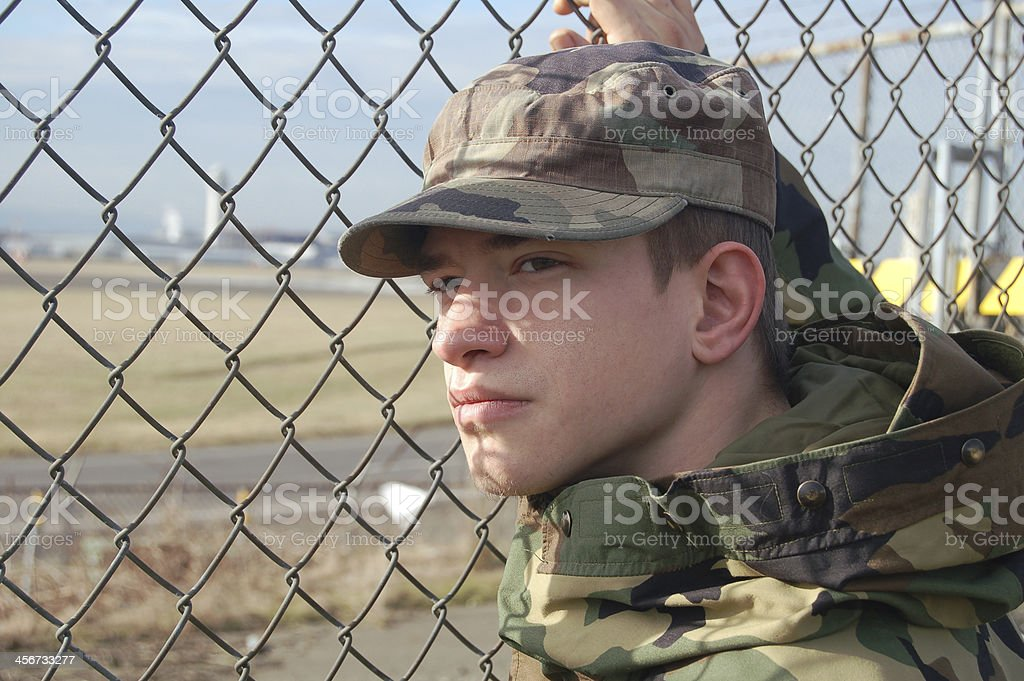 Military Man and Fence royalty-free stock photo