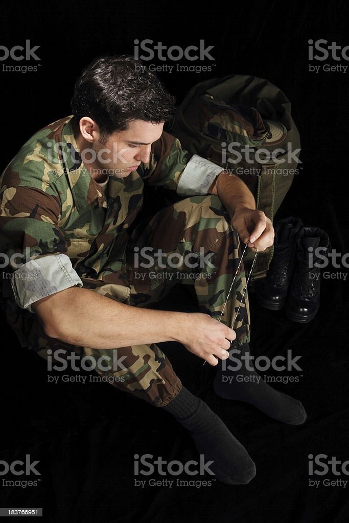 Military Man Depressed About Deployment Vertical royalty-free stock photo