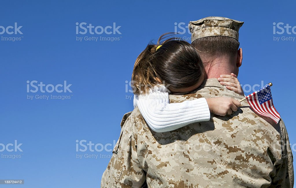 Military Man Hugs Daughter stock photo