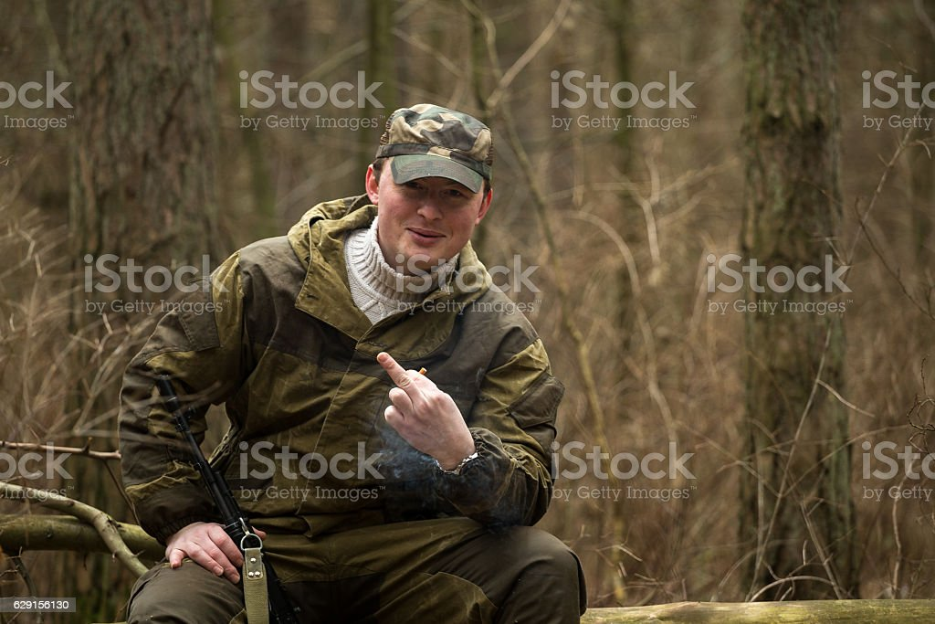 military man in the woods with a Kalashnikov assault rifle stock photo