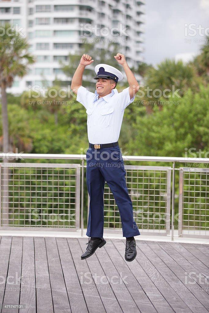 Military man jumping for joy royalty-free stock photo