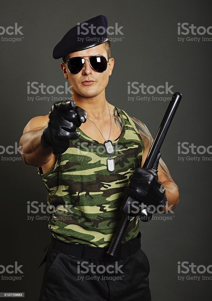 Military man shows on you stock photo