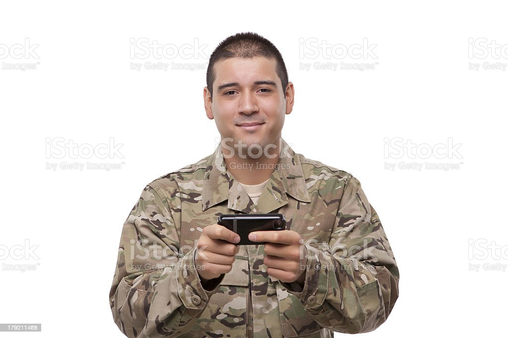 Military man texting royalty-free stock photo