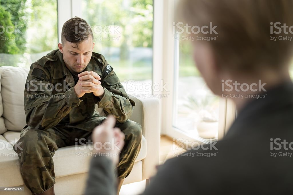 Military man visiting psychologist stock photo