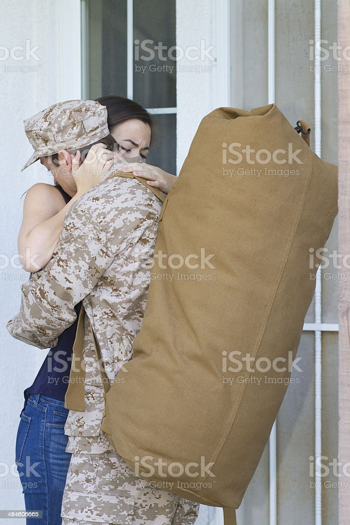 Military Man Wife Hugs on Porch Vertical royalty-free stock photo