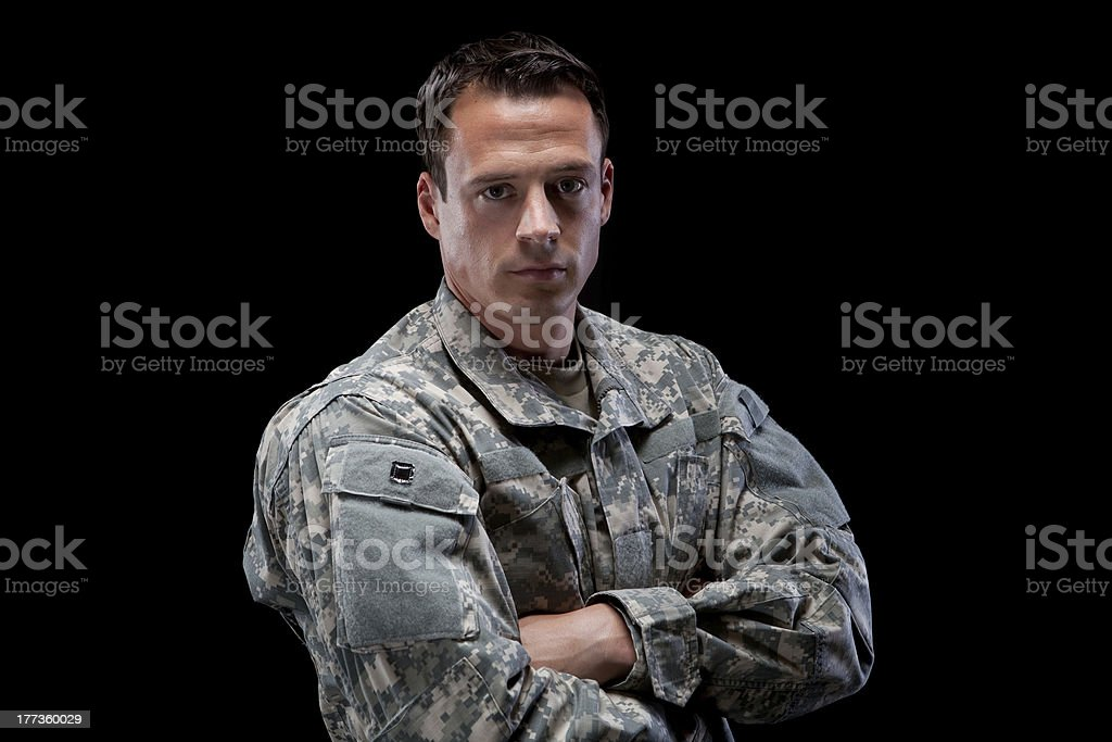 Military man with his arms crossed stock photo