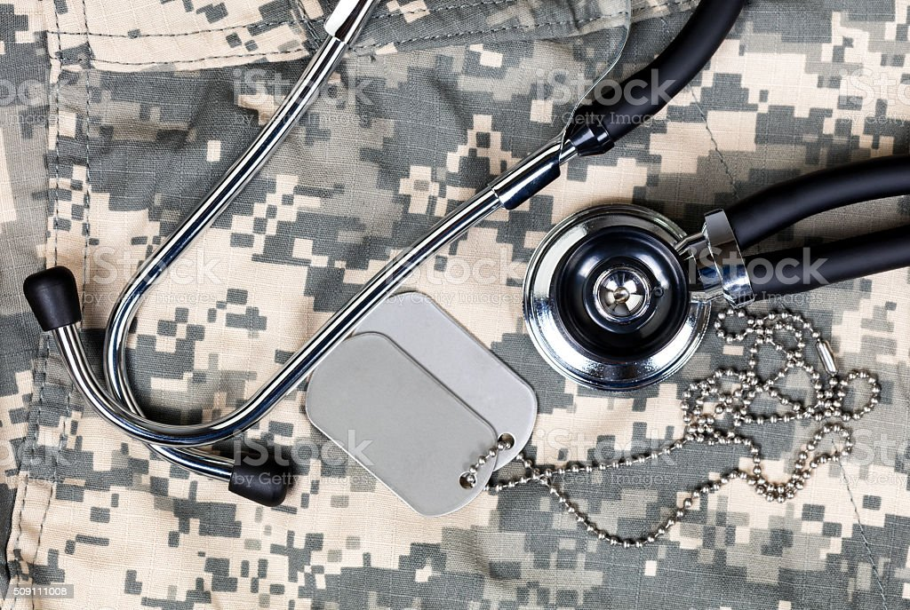 Military medical concept with stethoscope and identification tag stock photo