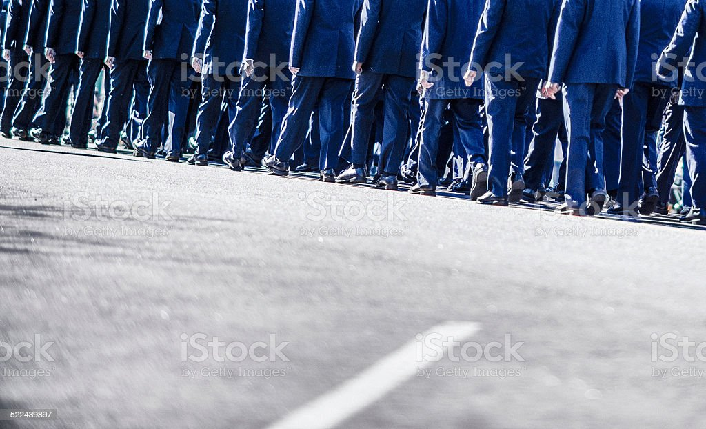 US military members walking in formation stock photo