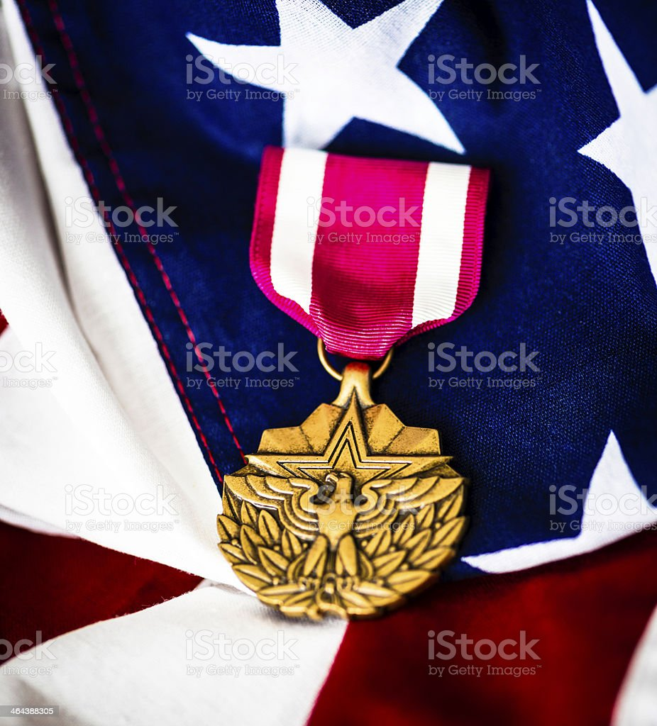 Military Meritorious Service Medal on American Flag royalty-free stock photo