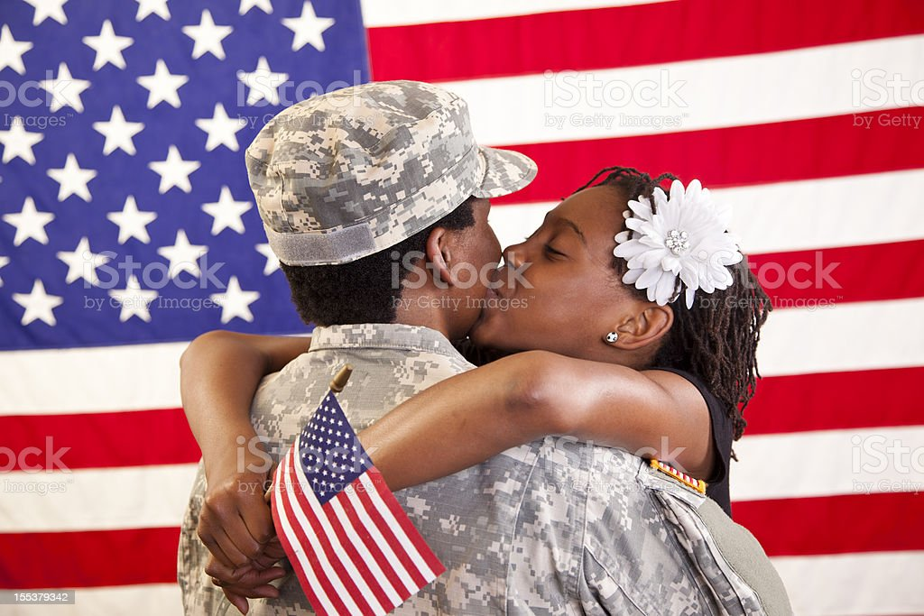 Military mom being welcomed home by daughter royalty-free stock photo
