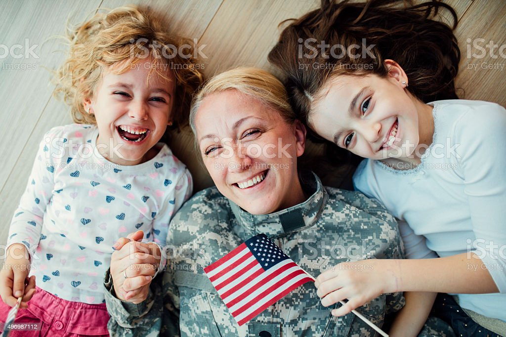 Military Mom Reunites With Her Little Girls. stock photo