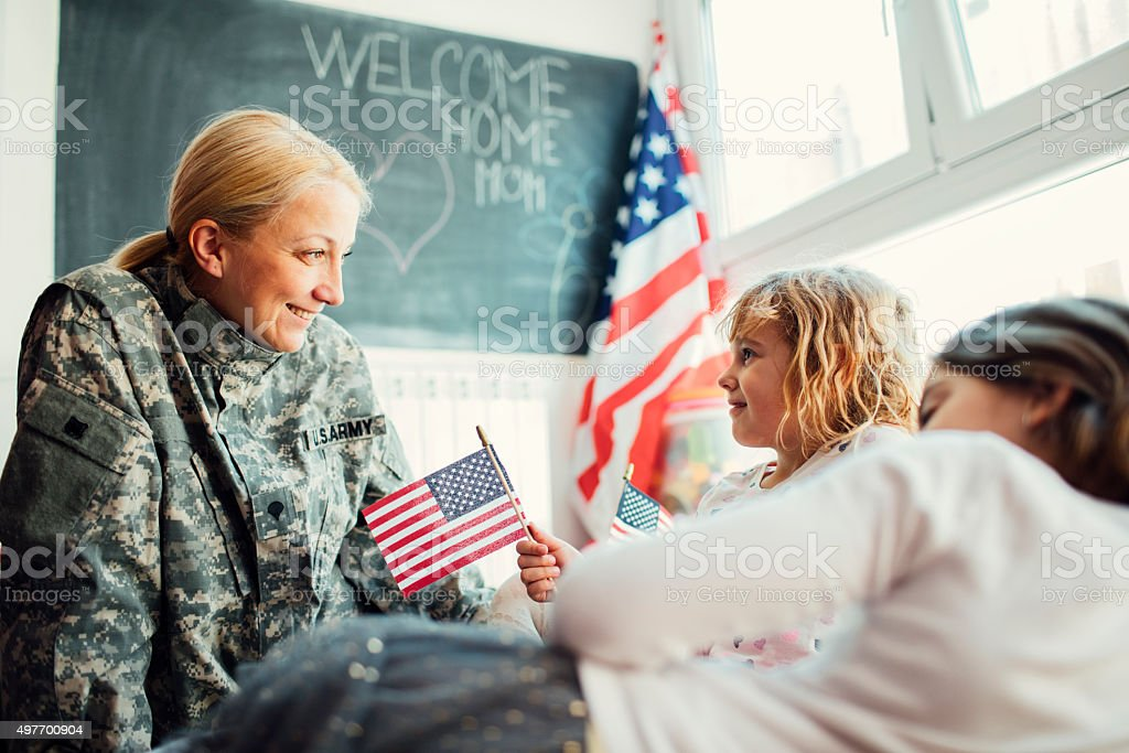 Military Mom talking With Her Kids stock photo
