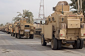 Military MRAP Trucks Ready For a Combat Convoy or Patrol