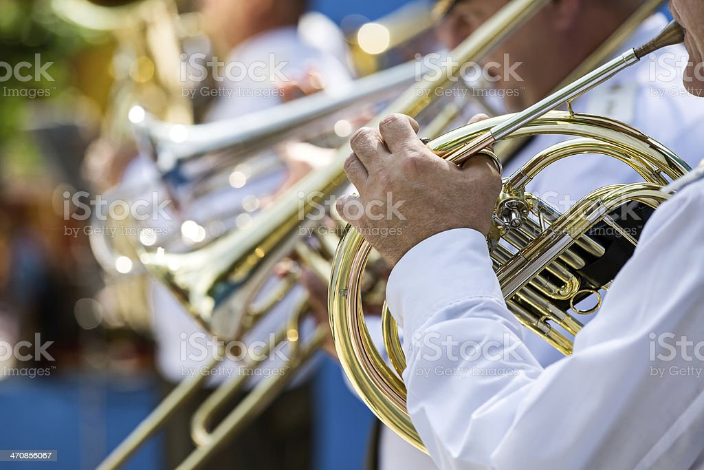 Military musician playing a horn stock photo