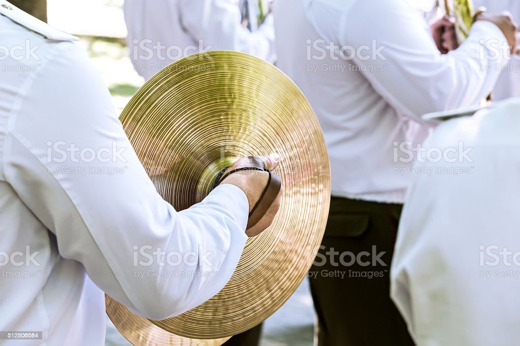military musician plays cymbal at the festival of brass bands stock photo