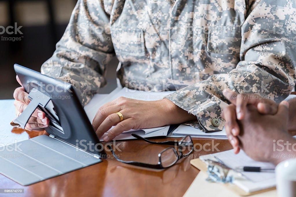 Military officer meeting with man in recruitment office stock photo
