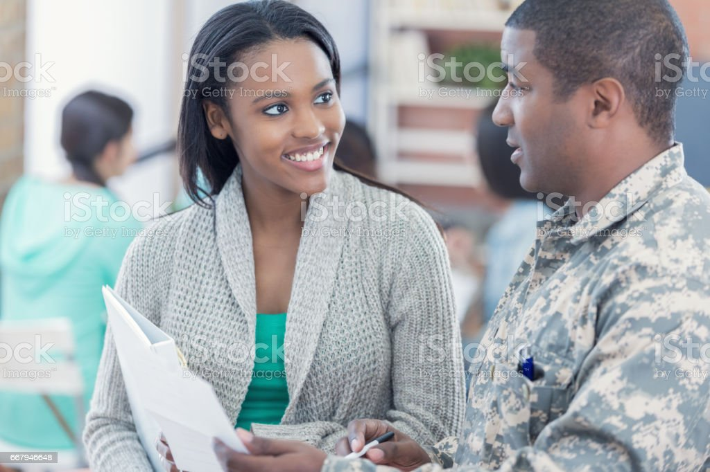 Military officer talks with student about enlistment stock photo