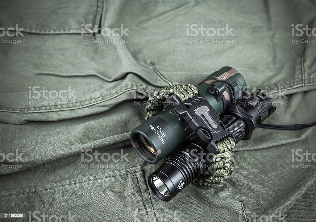 Military paracord bracelet, tactical torch and spy-glass stock photo