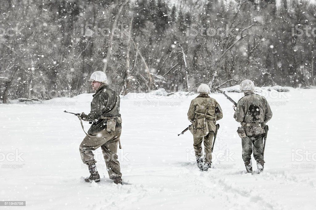 WWII US Military Patrol In a Winter Storm stock photo