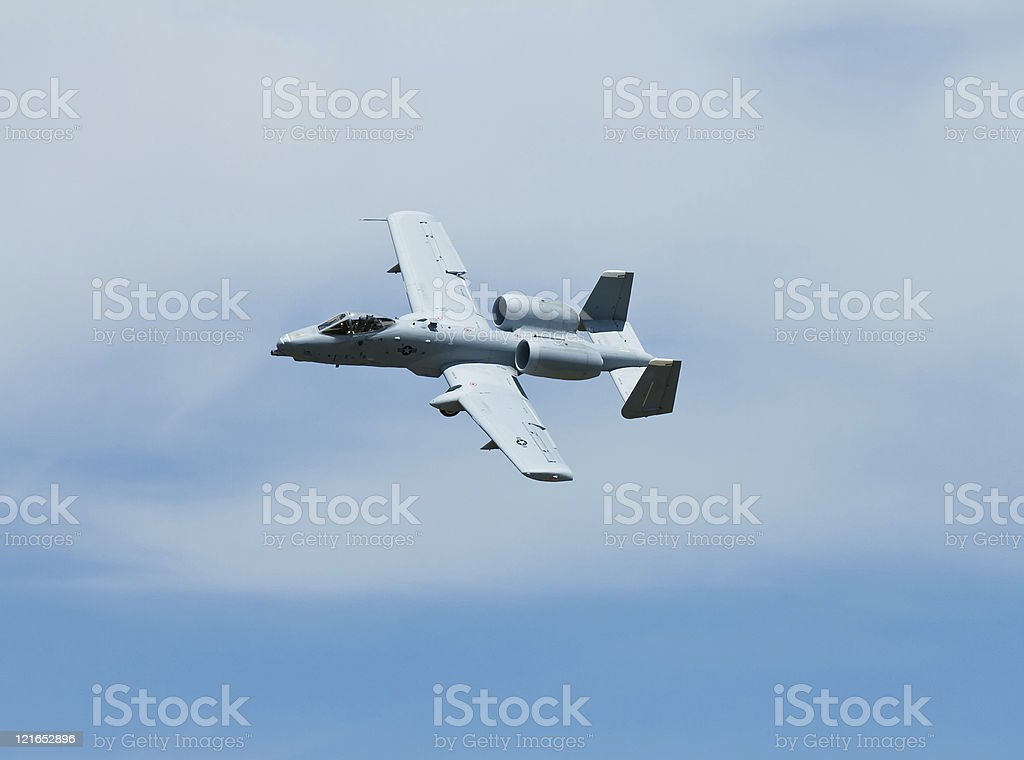 Military plane flying by stock photo