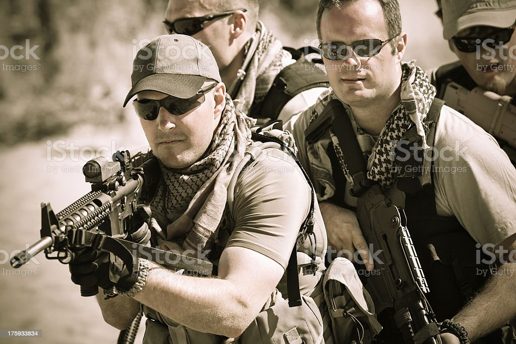 Military platoon of soldiers in desert royalty-free stock photo