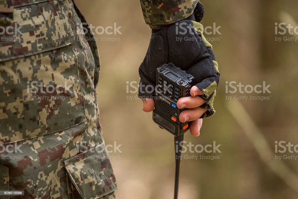 Military radio in forest, on the moss, close-up, stock photo