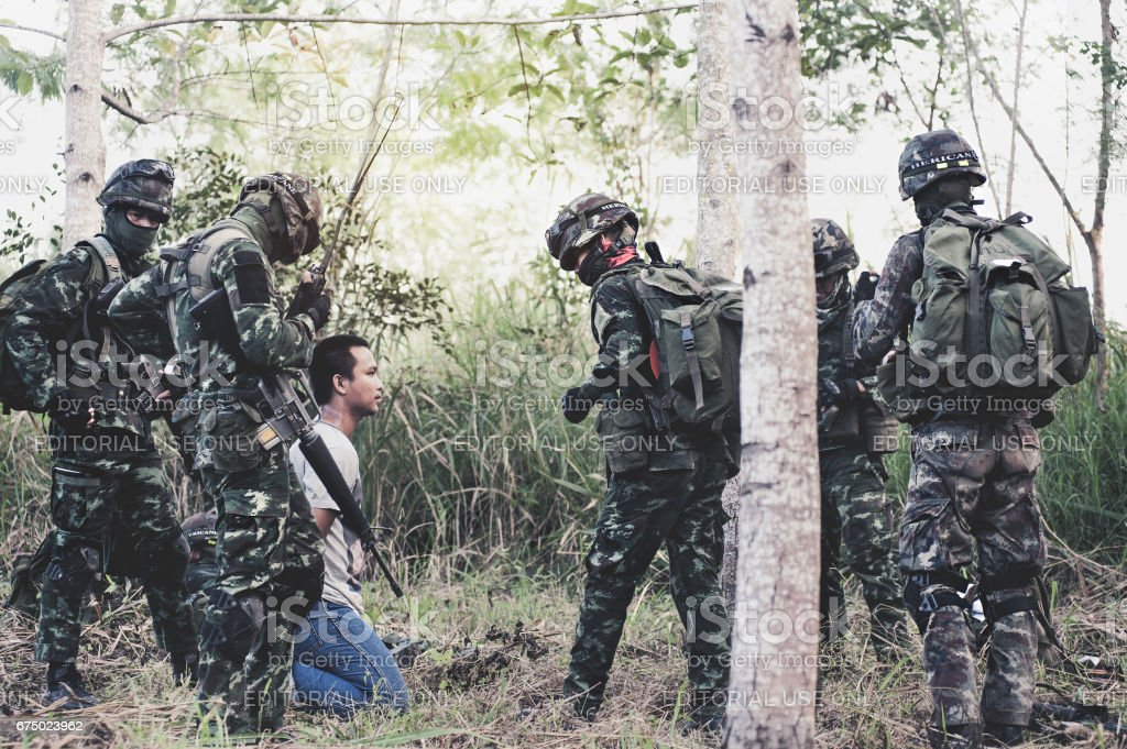 Military Rangers team in training, attack and arrest the terrorist stock photo