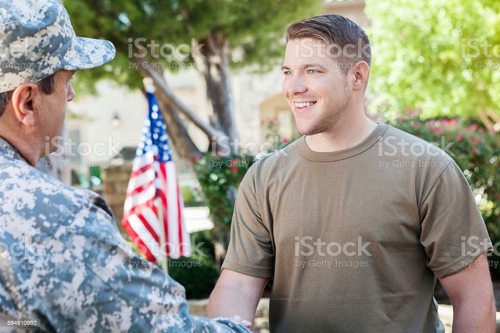 Military recruitment officer meeting with superior to discuss enlisting recruits stock photo