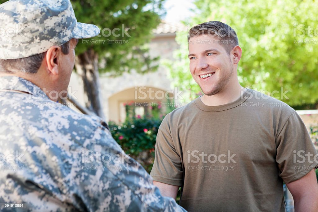 Military recruitment officers meeting to discuss enlisting recruits stock photo