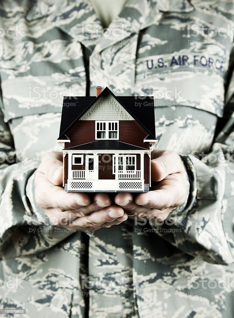 Military Relocation: Soldier with House royalty-free stock photo