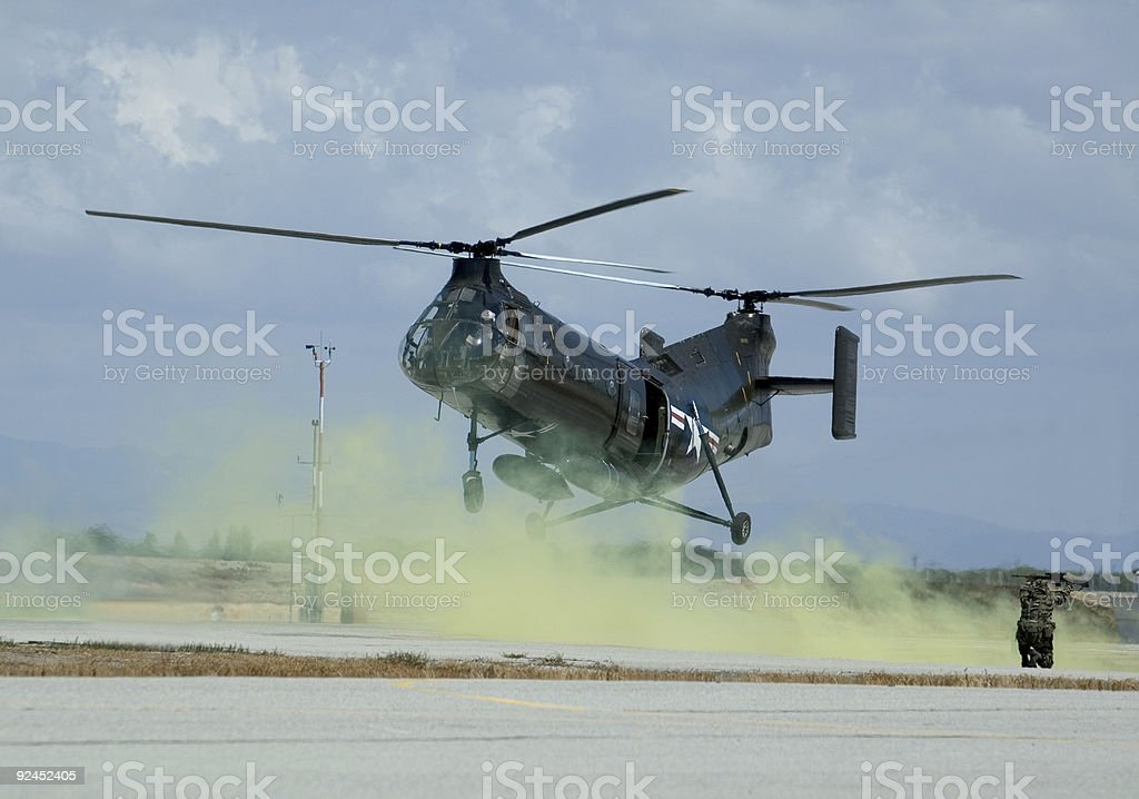 Military rescue exercise with an historic military helicopter royalty-free stock photo