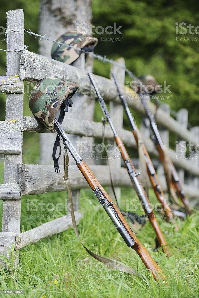 Military rifle and helmet royalty-free stock photo