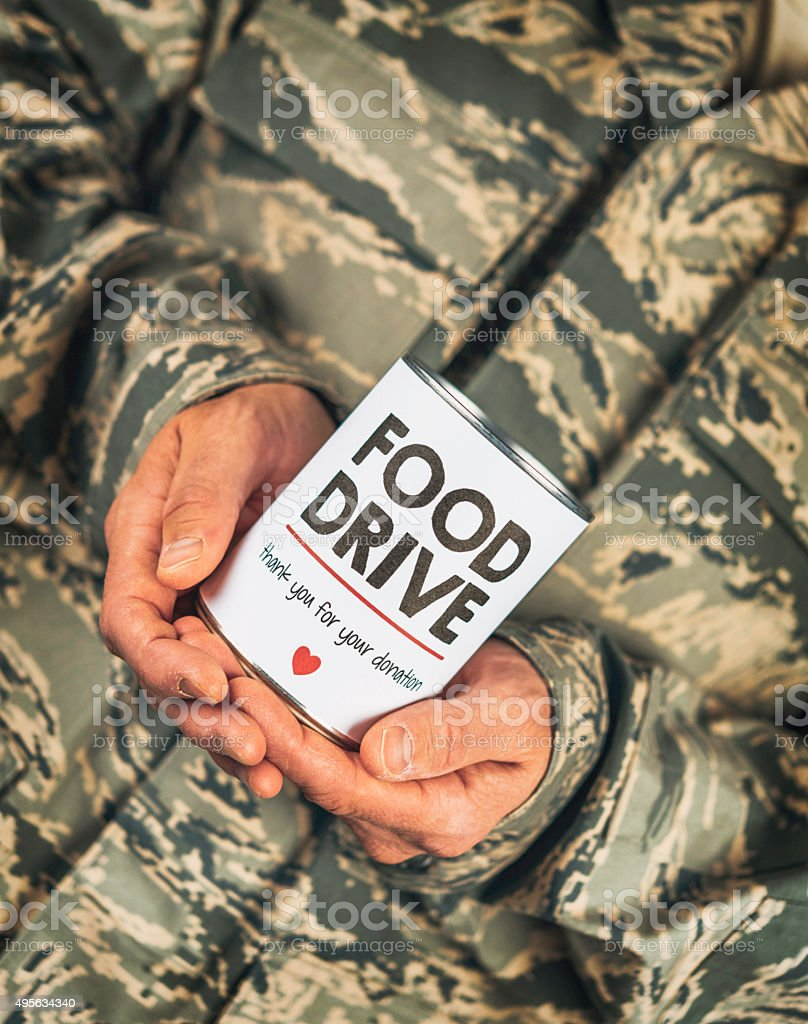Military service member advertising food drive stock photo