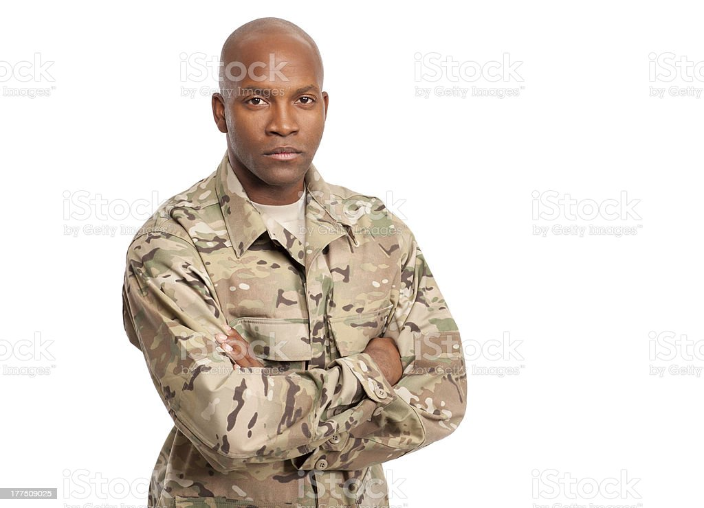 Military serviceman with his arms crossed royalty-free stock photo