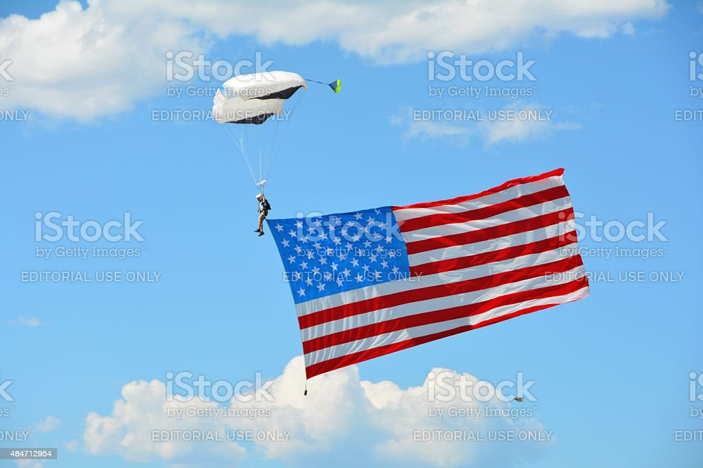 Military Skydiver with American Flag stock photo